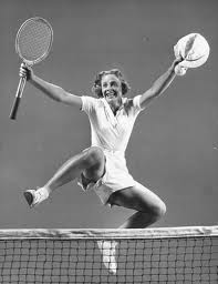 woman jumping over the net